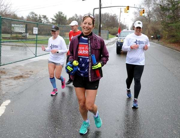 Eva Casale, front, runs along Ridge Road