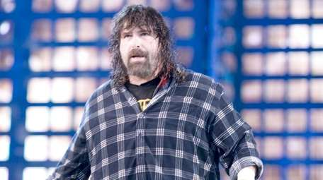 Mick Foley heads to the ring to face