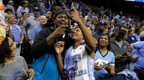 North Carolina's Nate Britt, right, and Villanova's Kris