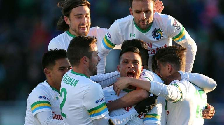 The New York Cosmos celebrate a goal by