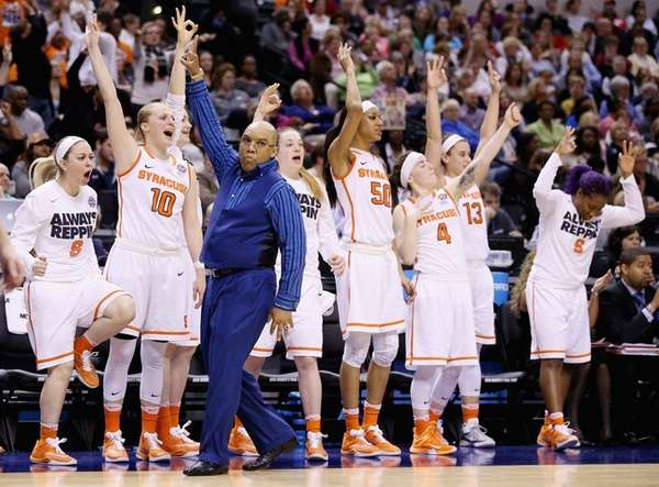 Syracuse coach Quentin Hillsman celebrates a three-pointer in
