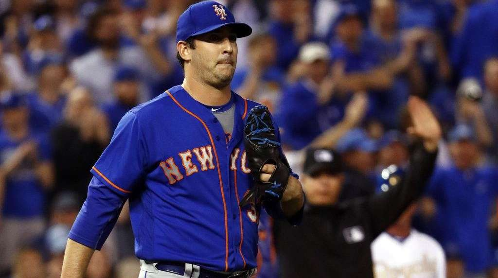 Mets starting pitcher Matt Harvey reacts after letting