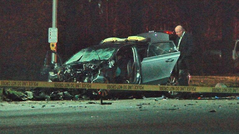 Investigators at the scene of a fatal accident