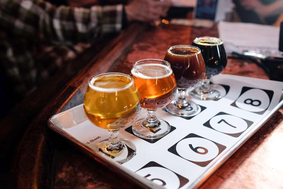 A flight of beers is served in apropos