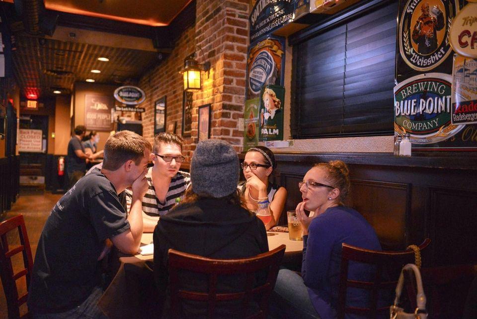 Patrons sip craft beers at The Lark Pub