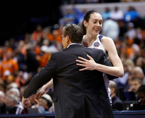 Connecticut's Breanna Stewart embraces coach Geno Auriemma as