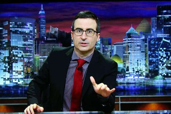 John Oliver accepts the TCA Award for