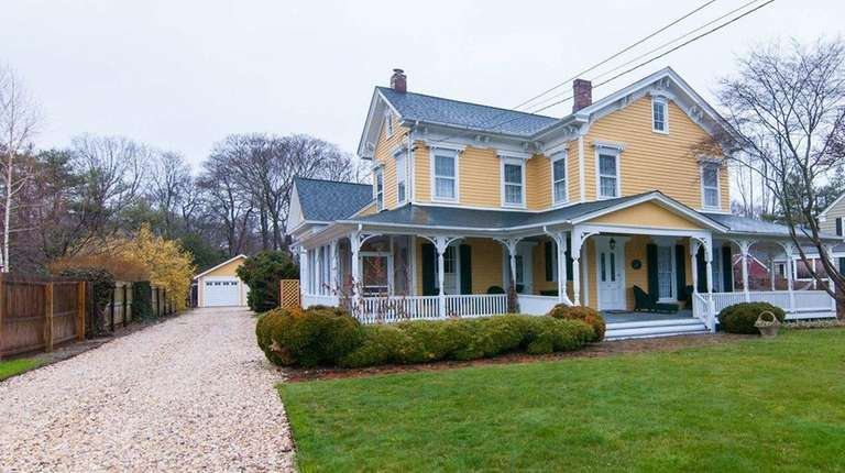 This 1873 Victorian with a graceful wrap-around porch