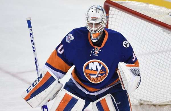 New York Islanders goalie Jean-Francois Berube protects the