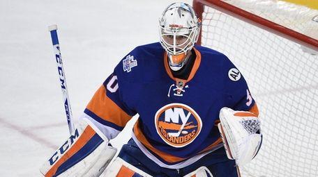 New York Islanders goalie Jean-Francois Berube protects the