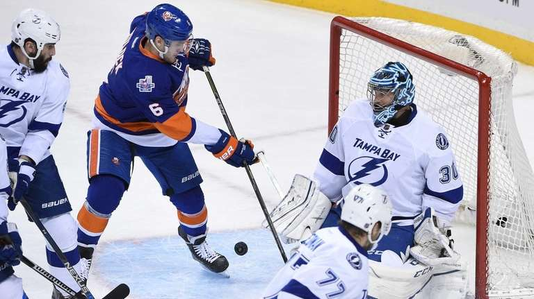 New York Islanders defenseman Ryan Pulock shoots and