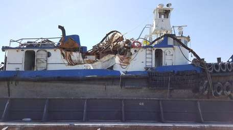 The damaged tug named Specialist sank in the