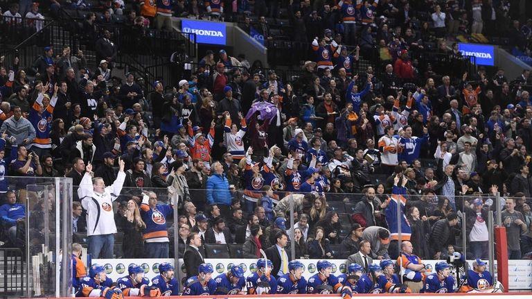New York Islanders fans celebrate a goal by