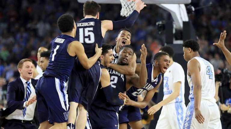 The Villanova Wildcats celebrate defeating the North Carolina