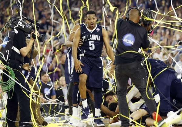 Villanova's Phil Booth (5) celebrates after the NCAA