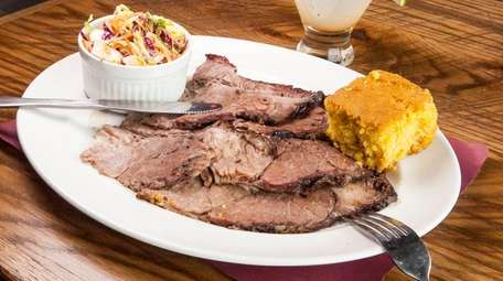Smoked brisket sells by the pound or platter,