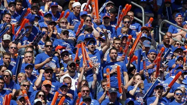 A group of New York Mets fans cheer