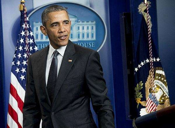 President Barack Obama leaves after speaking about the