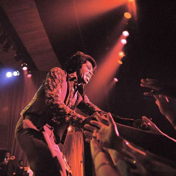 James Brown performs onstage in London on Sept.