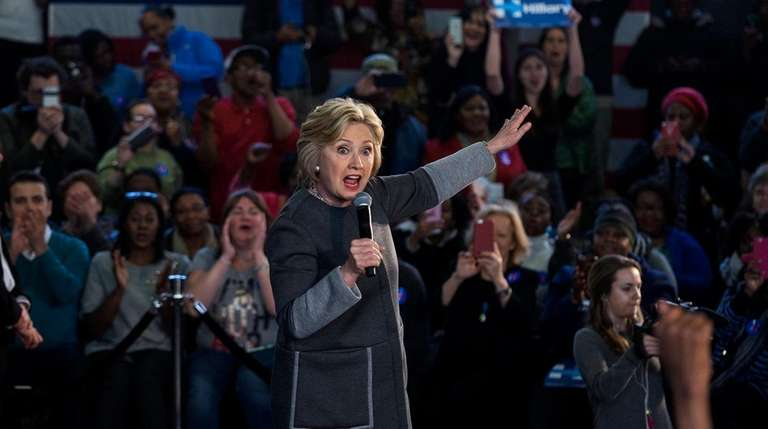 Democratic presidential candidate Hillary Clinton addresses a Women