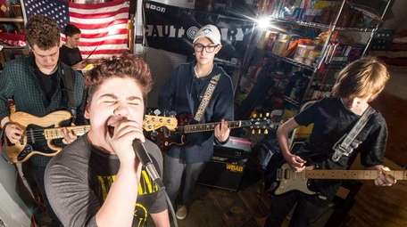 Cautionary band members rehearse in a Smithtown garage.