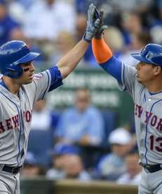 New York Mets second baseman Neil Walker celebrates
