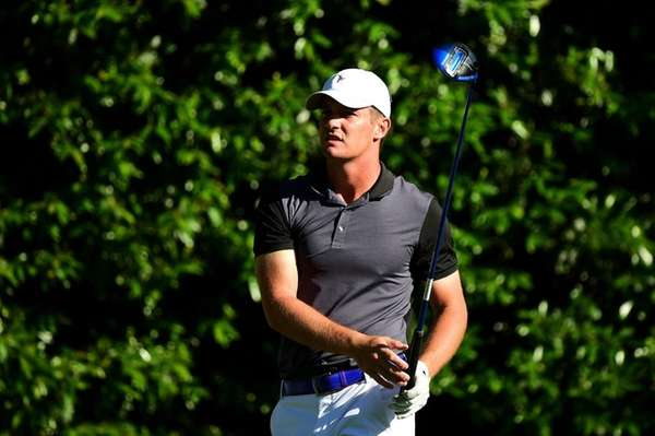 Bryson DeChambeau of the United States plays a