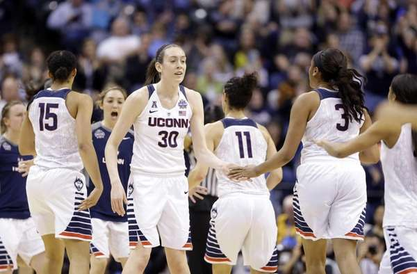 Connecticut's Breanna Stewart greets teammates during a timeout