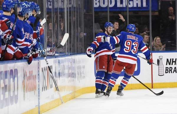 New York Rangers defenseman Keith Yandle congratulates New