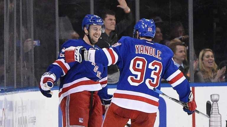 New York Rangers defenseman Keith Yandle congratulates New