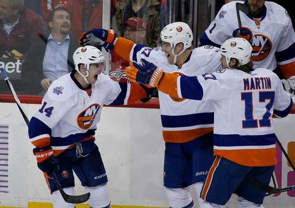 New York Islanders defenseman Thomas Hickey (14) celebrates