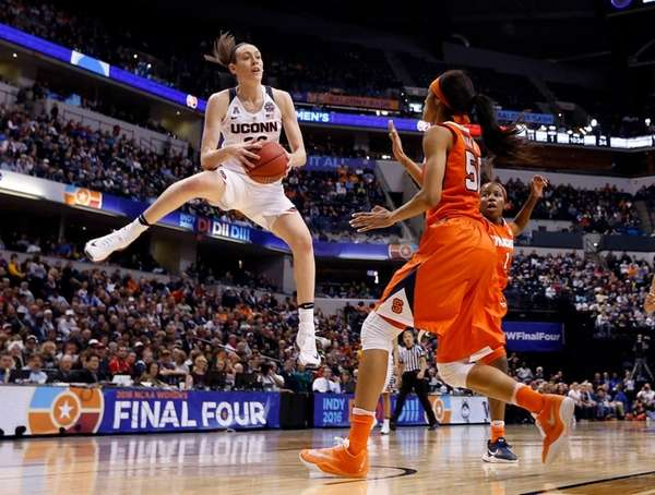 Connecticut's Breanna Stewart grabs a rebound as Syracuse's