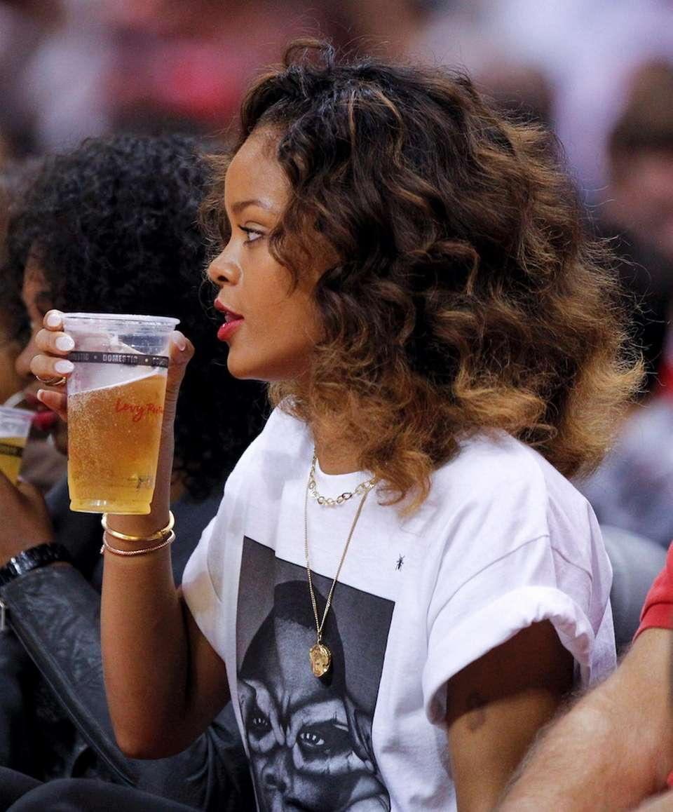 Singer Rihanna watches during the first half of