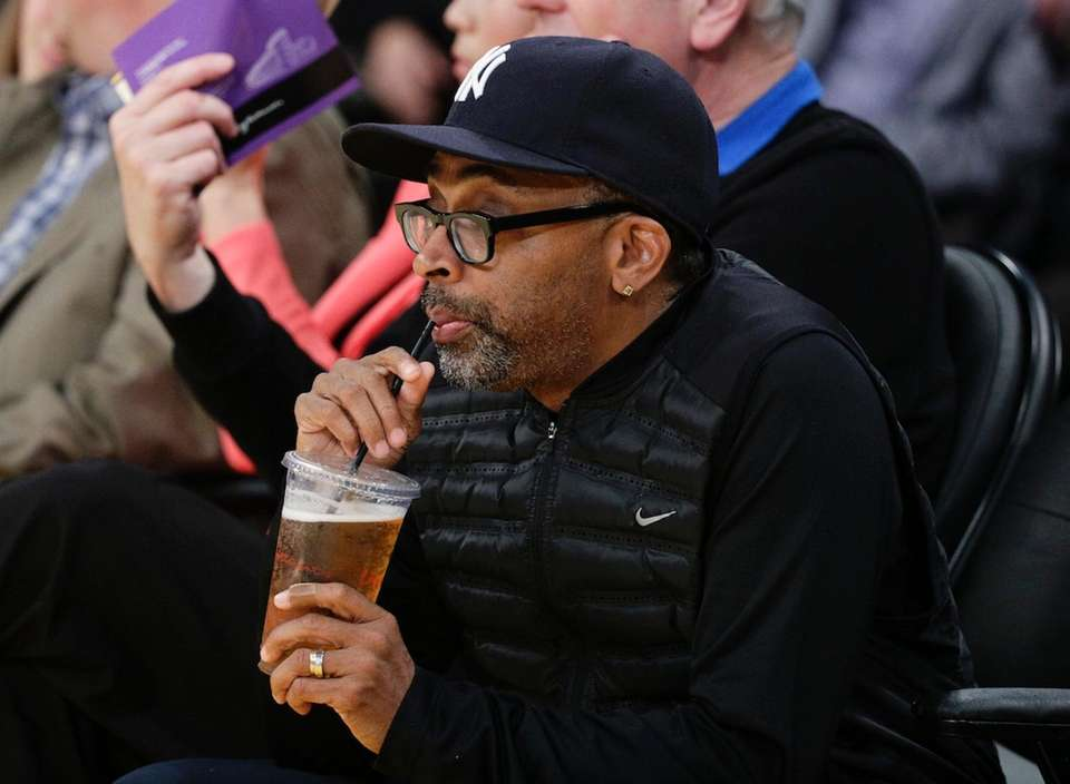 Director Spike Lee drinks his beer before an