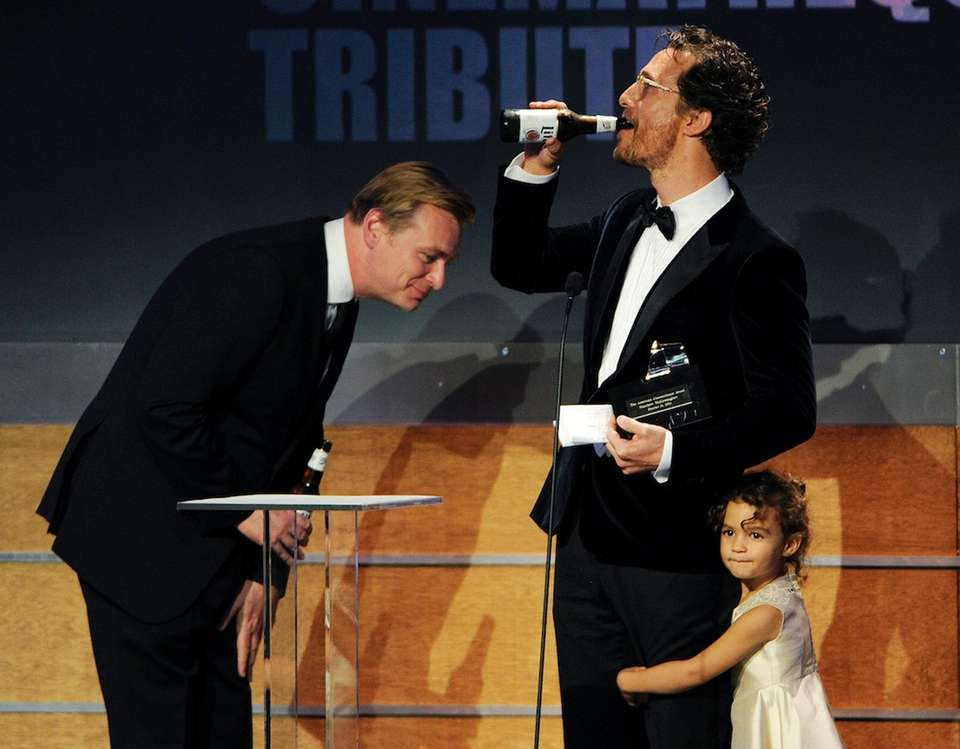 Honoree Matthew McConaughey enjoys a beer given to