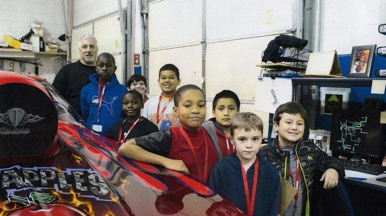 Vinny Budano shows a car to Kidsday reporters