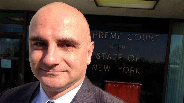 Attorney Gerard Misk stands outside New York State