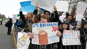 Protesters rally outside Grumman Studios in Bethpage, where