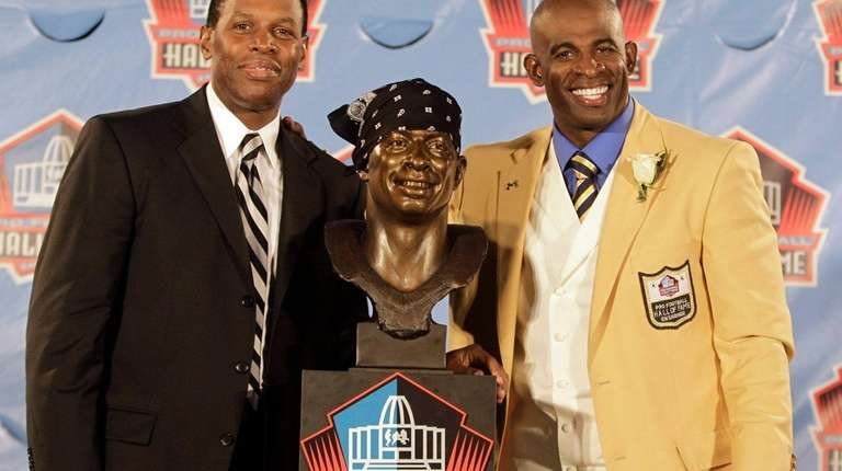 Eugene Parker. left, composed Hall of Famer Deion