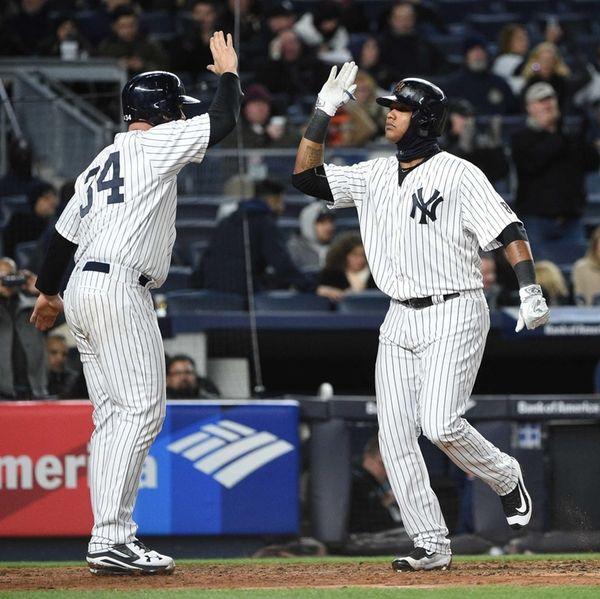 New York Yankees catcher Brian McCann congratulates New