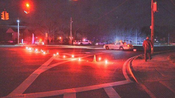 Police investigate the scene where a man was