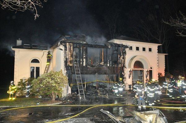 Firefighters battle a house fire on Seacrest