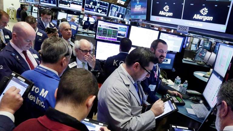 Traders gather at the post that handles Allergan