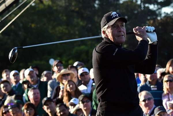 Honorary starter Gary Player tees off to begin