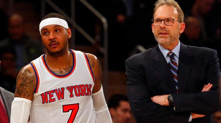 Carmelo Anthony and interim coach Kurt Rambis of