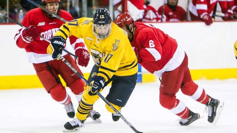 Quinnipiac's K.J. Tiefenwerth skates with the puck against