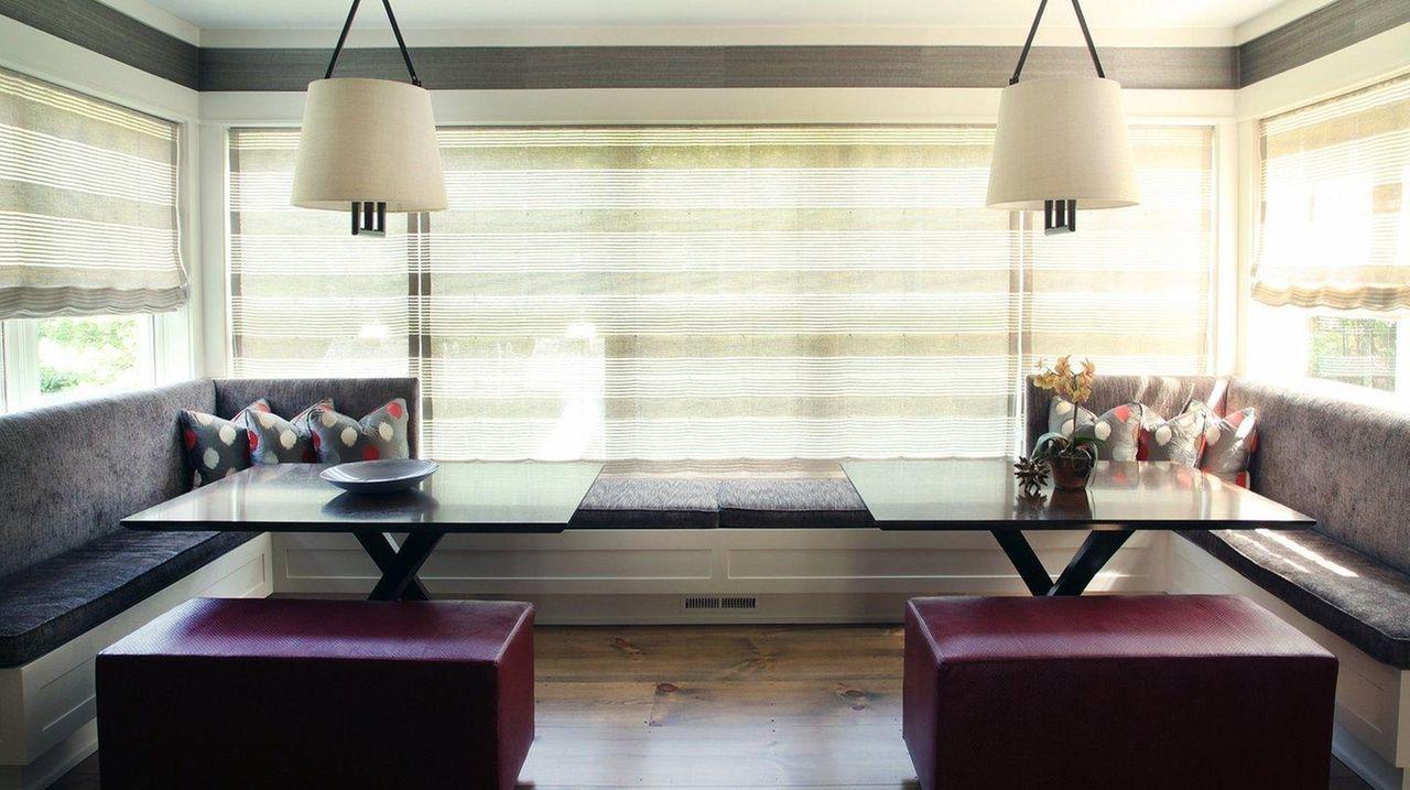 Designer Elsa Soyars used custom leather ottomans to