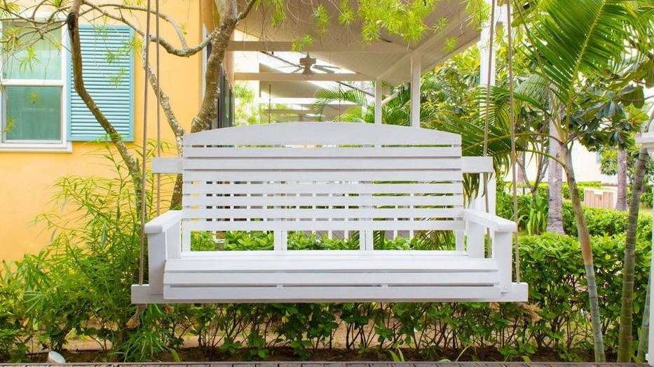 A porch swing offers a focal point, as