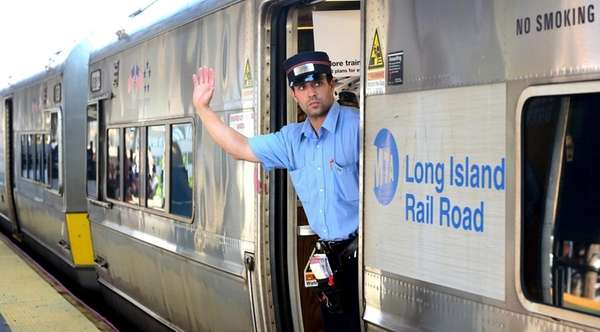 A Long Island Rail Road employee signals from