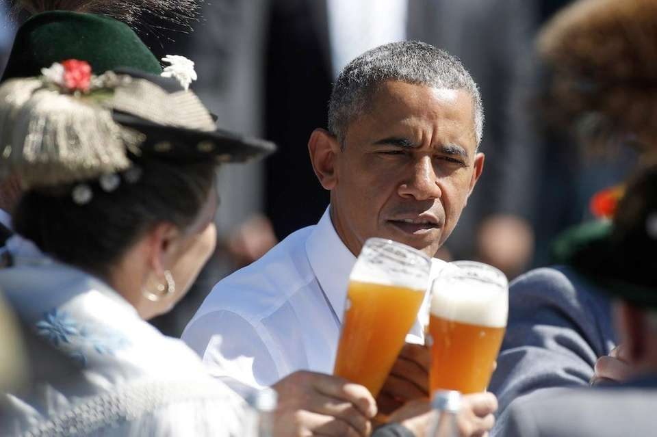 Barack Obama enjoys a beer in the morning